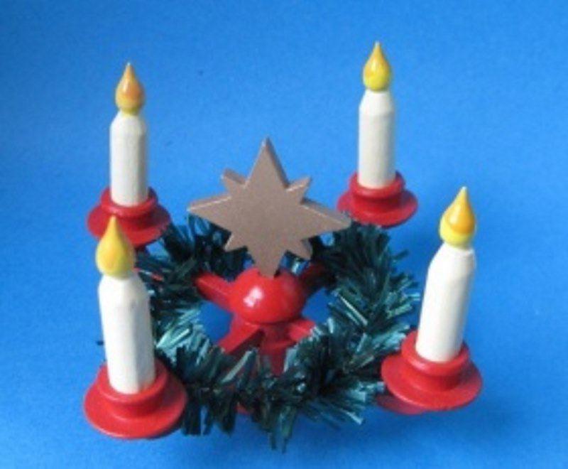 adventskranz mit stern kranz und kerzen weihnachtliche. Black Bedroom Furniture Sets. Home Design Ideas